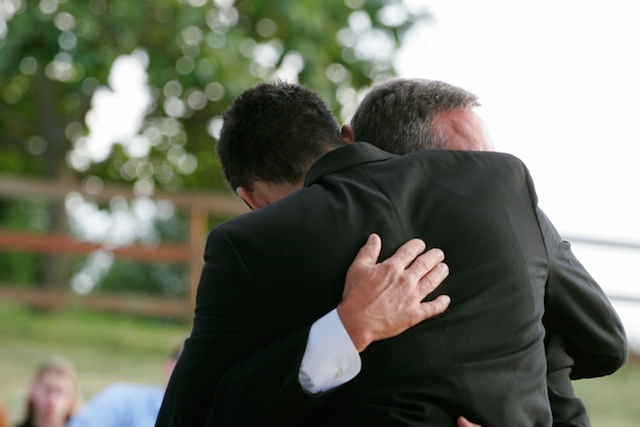 hug funeral death mourning men