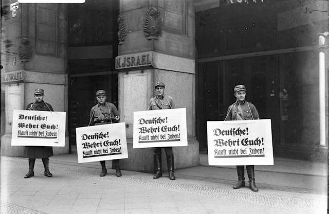 Members of the SA picket in front of a Jewish place of business during the Nazi boycott of Jewish businesses, 1 April 1933. (German National Archives/Wikimedia Commons)