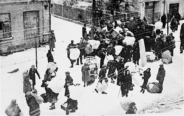 Jews being forced into the new Grodno Ghetto in Bezirk Bialystok, November 1941. (Emanuel Ringelblum Jewish Historical Institute of Poland/Wikimedia Commons)