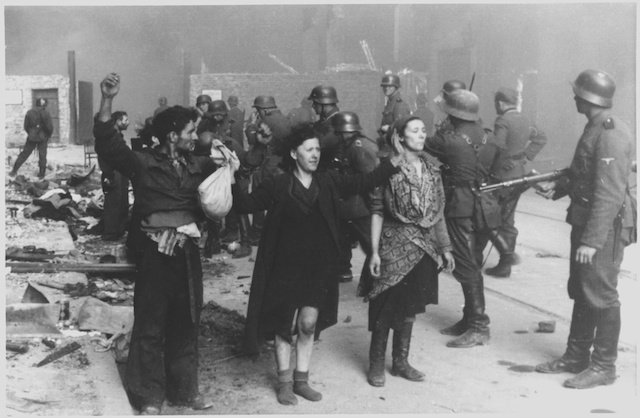 Nazis arresting Jewish participants in the Warsaw Ghetto Uprising, 1943. (Stroop Report/Wikimedia Commons)