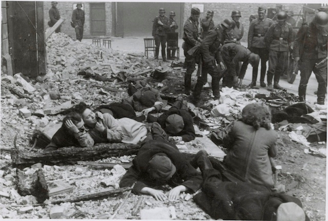 Jews being pulled from a bunker during the Warsaw Ghetto Uprising, 1943. (Stroop Report/Wikimedia Commons)