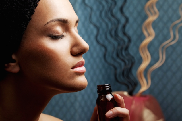 aroma; pleasure; therapy; spa; wellness; fresh; relax; sense; profile, face; woman, white, young, beautiful,   bottle; healthcare; freshness; vitality; harmony; purity;