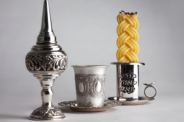 A Havdalah set consists of a spice box, kiddush cup and braided candle.