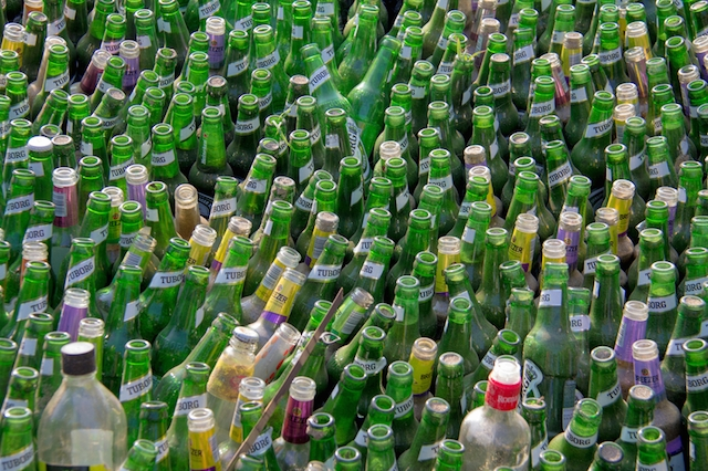 Arambol, India - February 12, 2013: Lots of empty bottles (mainly of beer) after a party, ready to be recycled. It was shot in Arambol beach in Goa, India a hub for western tourists.
