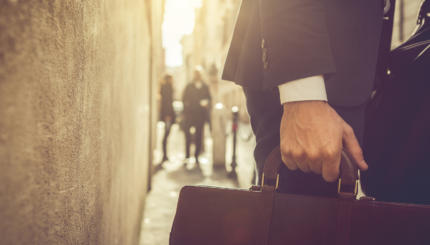 Business person walking with briefcase