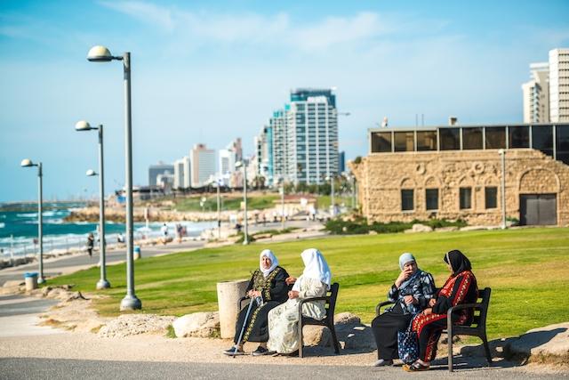 Arab-Israeli women stting at the beach in Tel Aviv. (iStock)