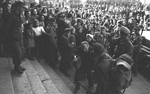 Hungarian and German soldiers round up arrested Jews at the City Theater  in Budapest, October 1944. (German Federal Archives)