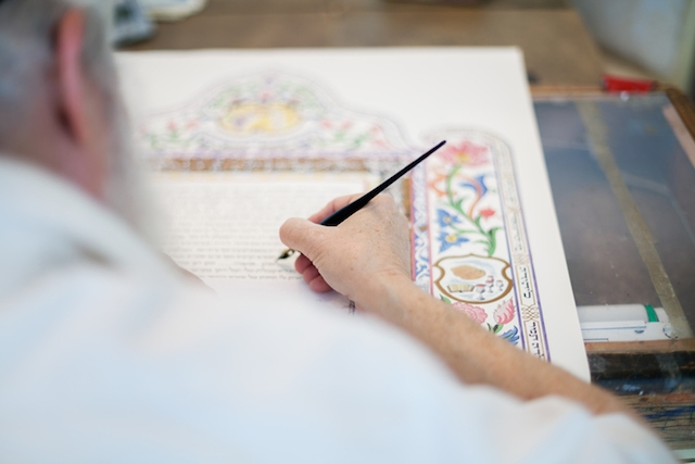 Scribe filling in a Ketubah, a Jewish wedding contract