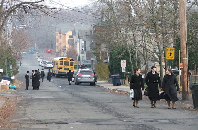 Traditionally dressed Hasidic men and women in New Square, a Hasidic enclave in New York State in 2015. (Uriel Heilman)