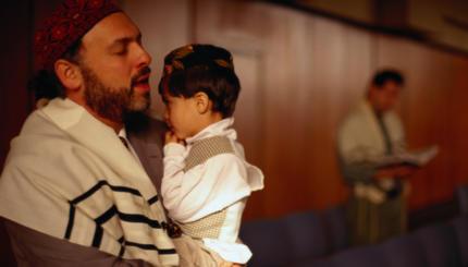 Jewish Man Holding Son and Praying