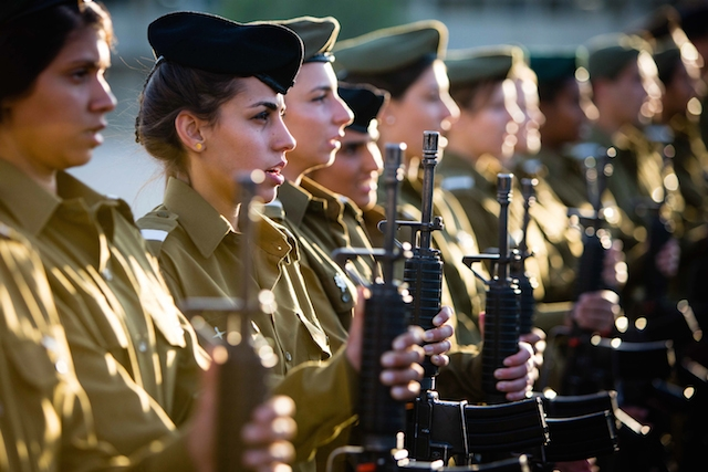 Female soldiers of the IDF stand in formation at a military ceremony in 2014. (iStock)