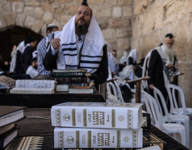 prayer at kotel shutterstock