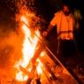 jewish man by bonfire in mt meron, israe