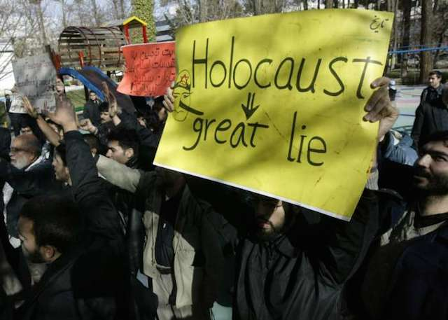 Demonstrators at a rally claiming the Holocaust never occurred. (United States Holocaust Memorial Museum)