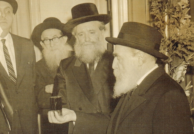 Moshe Feinstein (right) with Rabbi Yona Shtencel and others, date unknown. (Wikimedia Commons)