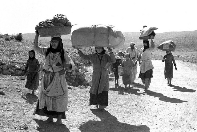 Palestinian Arabs fleeing their Galilee villages as Israeli troops approach, Oct. 30, 1948. (Eldan David/Israel Government Press Office)