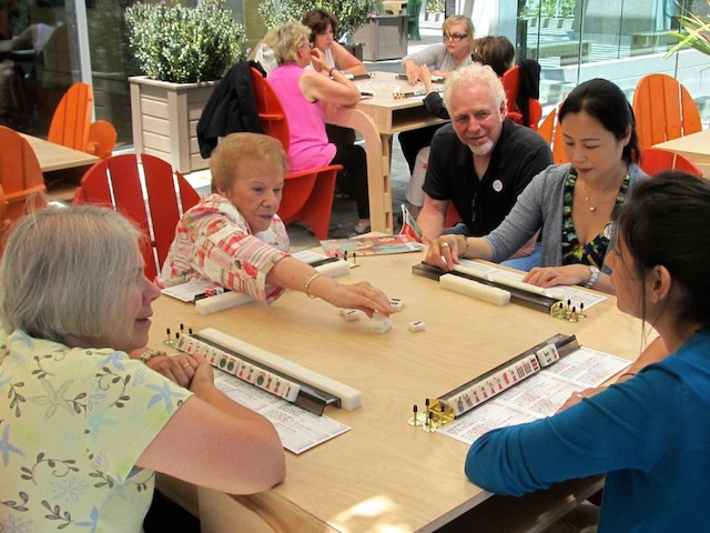 A friendly mah jongg game on the terrace of the Skirball Cultural Center in Los Angeles, 2012. (Edmon J. Rodman/JTA)