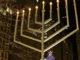 Hanukkah menorah across from Christmas tree in downtown plaza