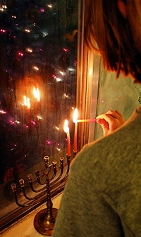 03_girl_and_menorah_in_window.jpg
