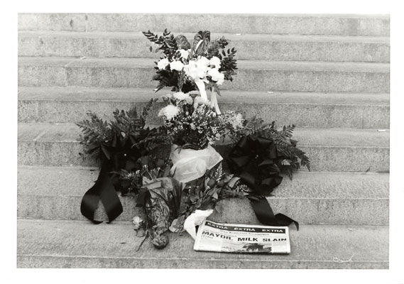 1978: Flowers and San Francisco Examiner at City Hall steps the day after the assassinations. James C. Hormel Gay & Lesbian Center, San Francisco Public Library.