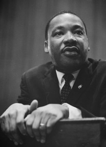 348px-Martin-Luther-King-1964-leaning-on-a-lectern