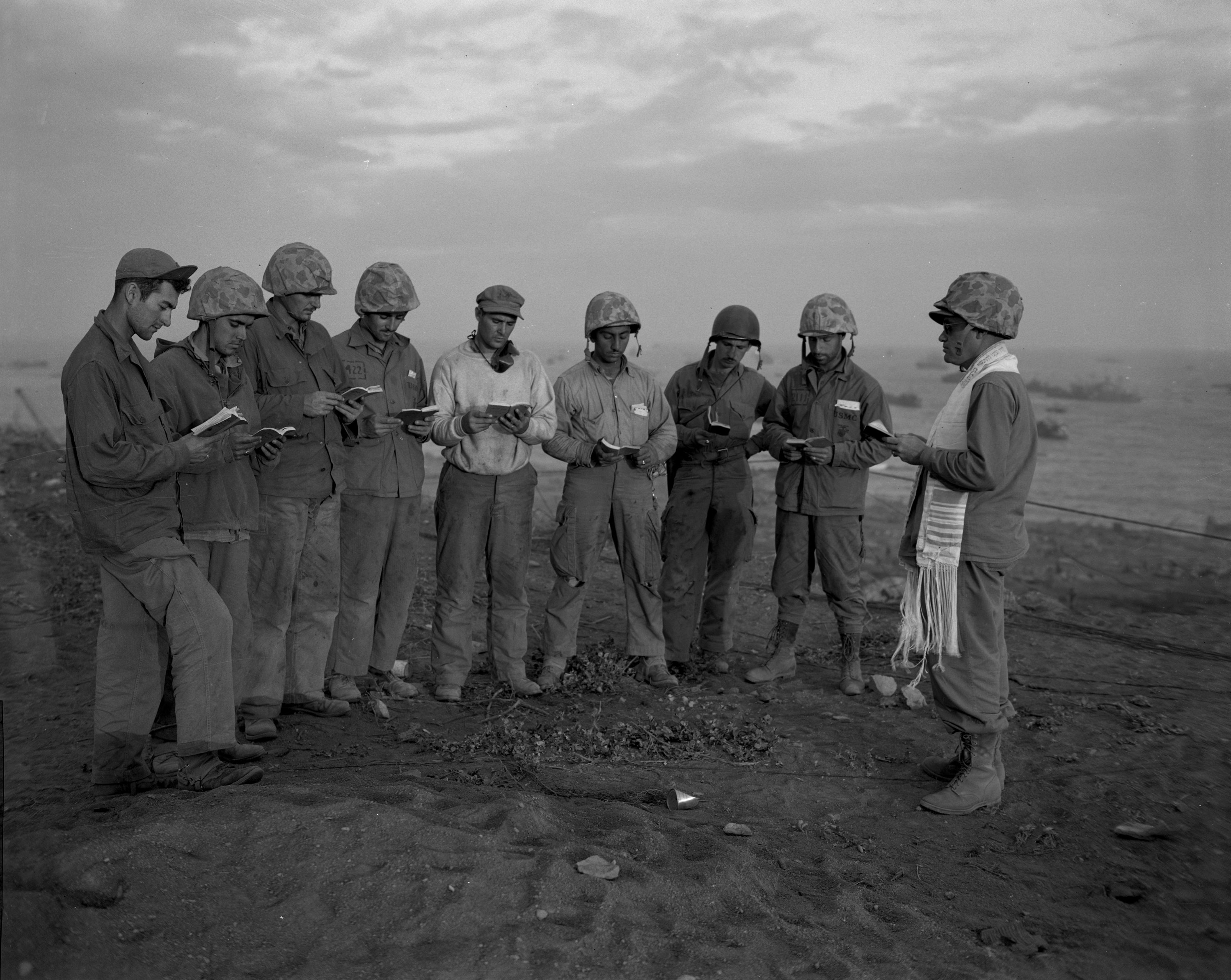 Rabbi Roland Gittelsohn, far right, conducting the first Jewish service for members of the 5th MarDiv--Iwo Jima, February 1945