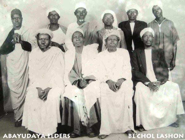 (Seated left to right). Rabbi Yonadav Keki ( Rabbi Sizomu's father), Rabbi Samson Mugombe(Rabbi Sizomu's Grandfather),Rabbi Zakayo Mumbya, Rabbi Yaakov Were. (Standing left to right, Gabbaim) Solomon Ndu, Yechu Wetege, Eliyahu Musamba, Yaakov Kasakya, Peter Mubbale, Yechoas Kaweke