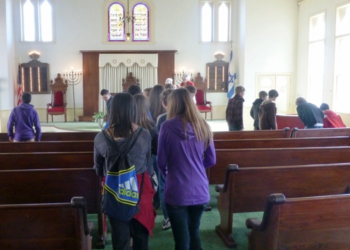 Students enter the sanctuary of Temple Beth-El in Corsicana, Texas.