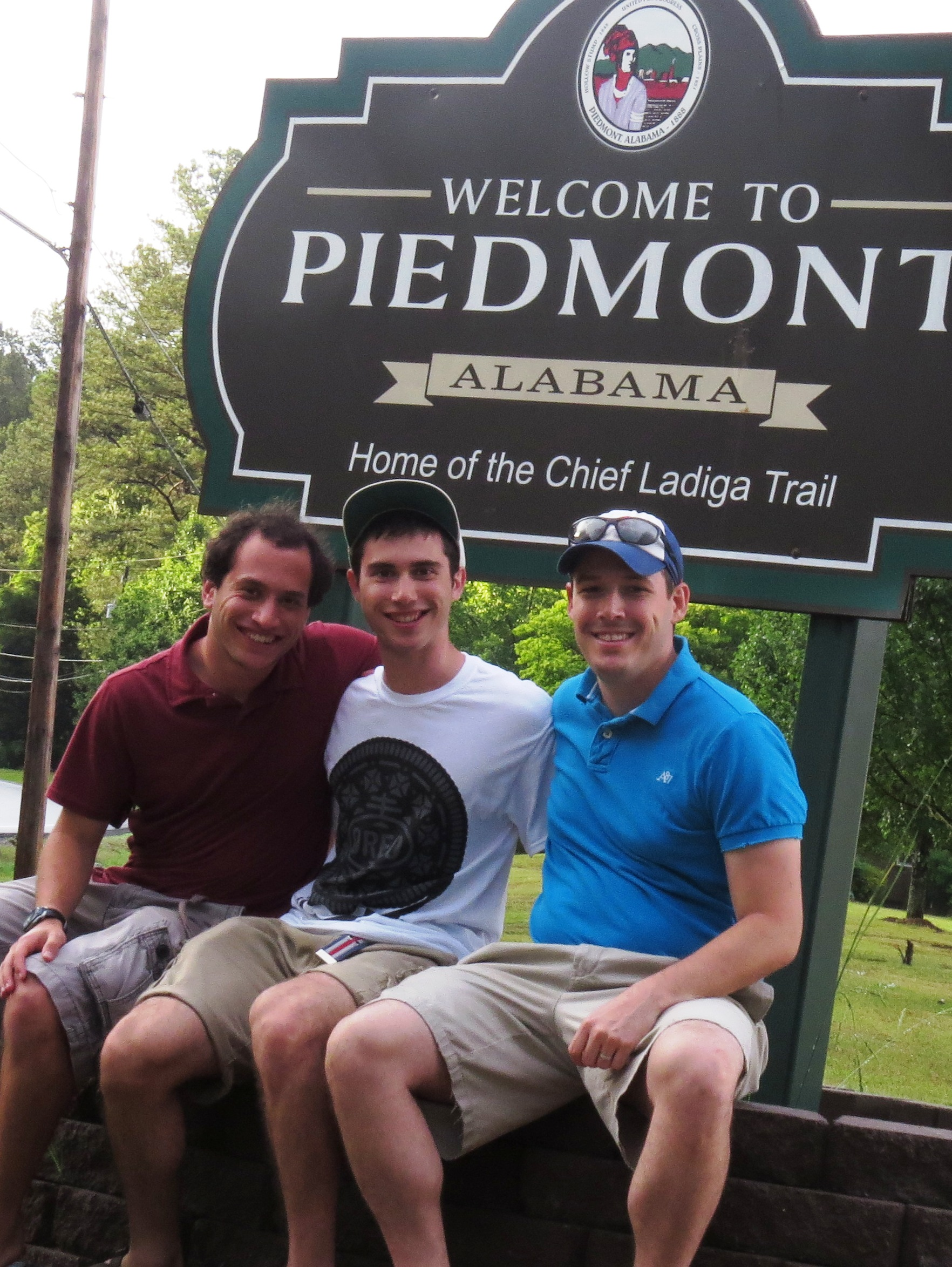 Gabe, Brother and Cousin in front of sign
