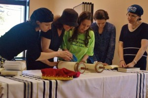 women and girls reading torah at a shulchan