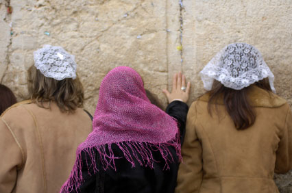 Jewish women wearing head coverings at the Western Wall.