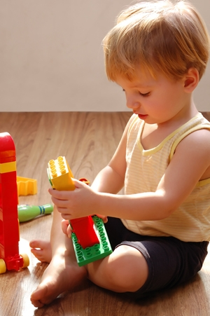 child baby playing blocks