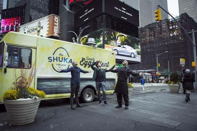 guys in front of shuka truck