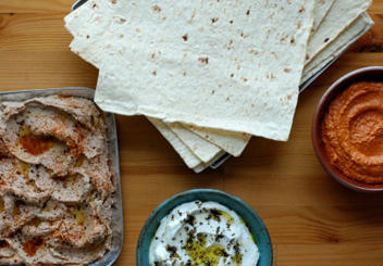 Hummus, yogurt, pita are all part of an Israel Breakfast