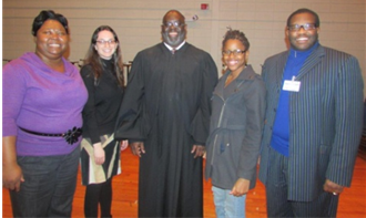 L-R: Dr. LeSian Chase, Counselor, Whitten Middle School, Malkie Schwartz, Director, ISJL Dept. of Community Engagement, Judge Carlton Reeves, Gernelle Nelson, AmeriCorps member, ISJL Dept. of Community Engagement and Mr. Anthony Moore, Principal, Whitten Middle School