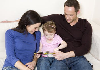 parents reading to their child