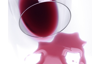 We spill drops of wine while reciting each of the Ten Plagues.