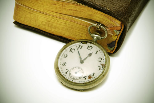 old book with watch