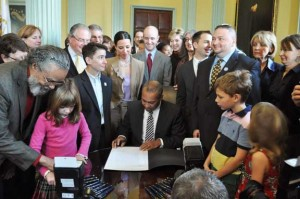 Gov. Deval Patrick signing the Transgender Equal Rights Bill