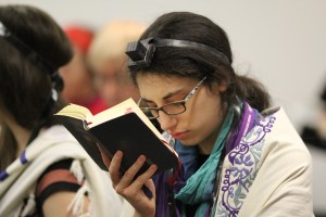 A woman praying at the partnership minyan that was held at the 2013 JOFA conference in NYC.