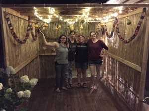 Erica and friends in the decorated sukkah!