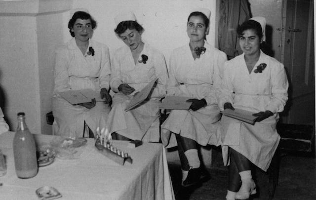1954 graduates of the Shaare Zedek Hospital school of nursing at a graduation ceremony in Jerusalem. It was taken on the third day of Hanukkah, as three candles are lit on the menorah. (Wikimedia Commons)