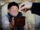 giving coin to beggar tzedakah