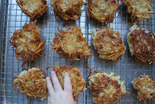 hand with latkes