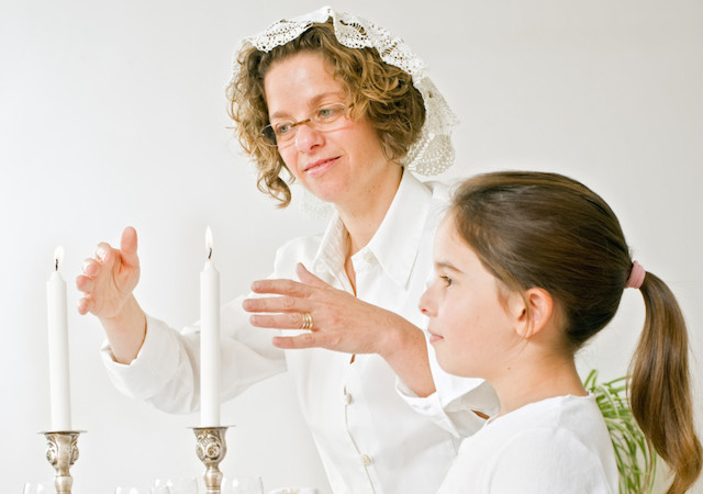 mother and daughter shabbat candels