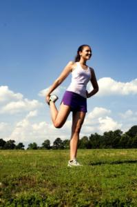 female-at-quadriceps-stretching-position-361x544