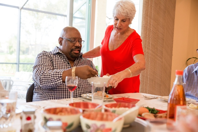 passover seder african american man white woman