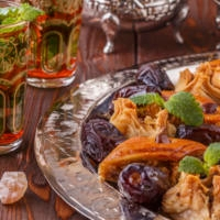 Moroccan mint tea in the traditional glasses with sweets, selective focus.