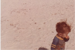 Me, many years ago, on the beach in Florida enjoying a snack...