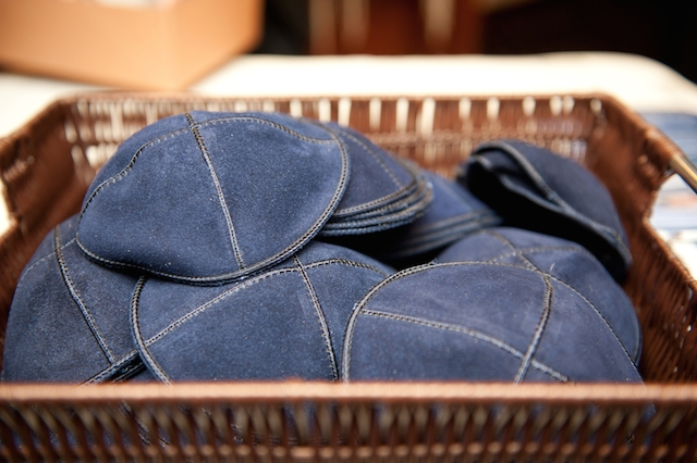 A basket of blue, custom stitched yarmulkes.